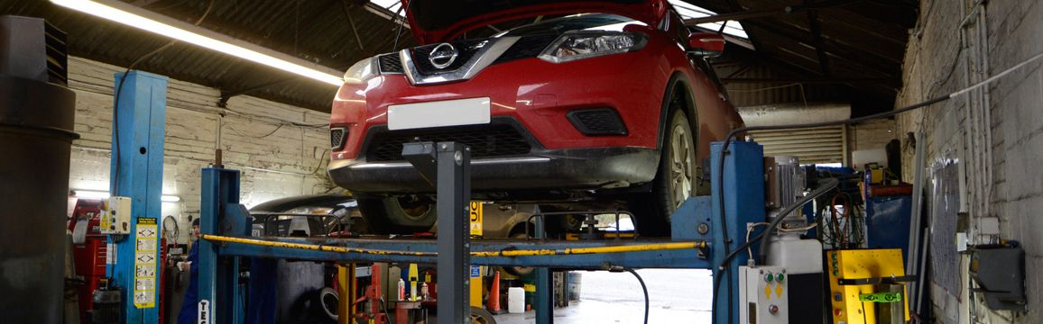 A.C.H. Autos Telford car on lift in garage image.